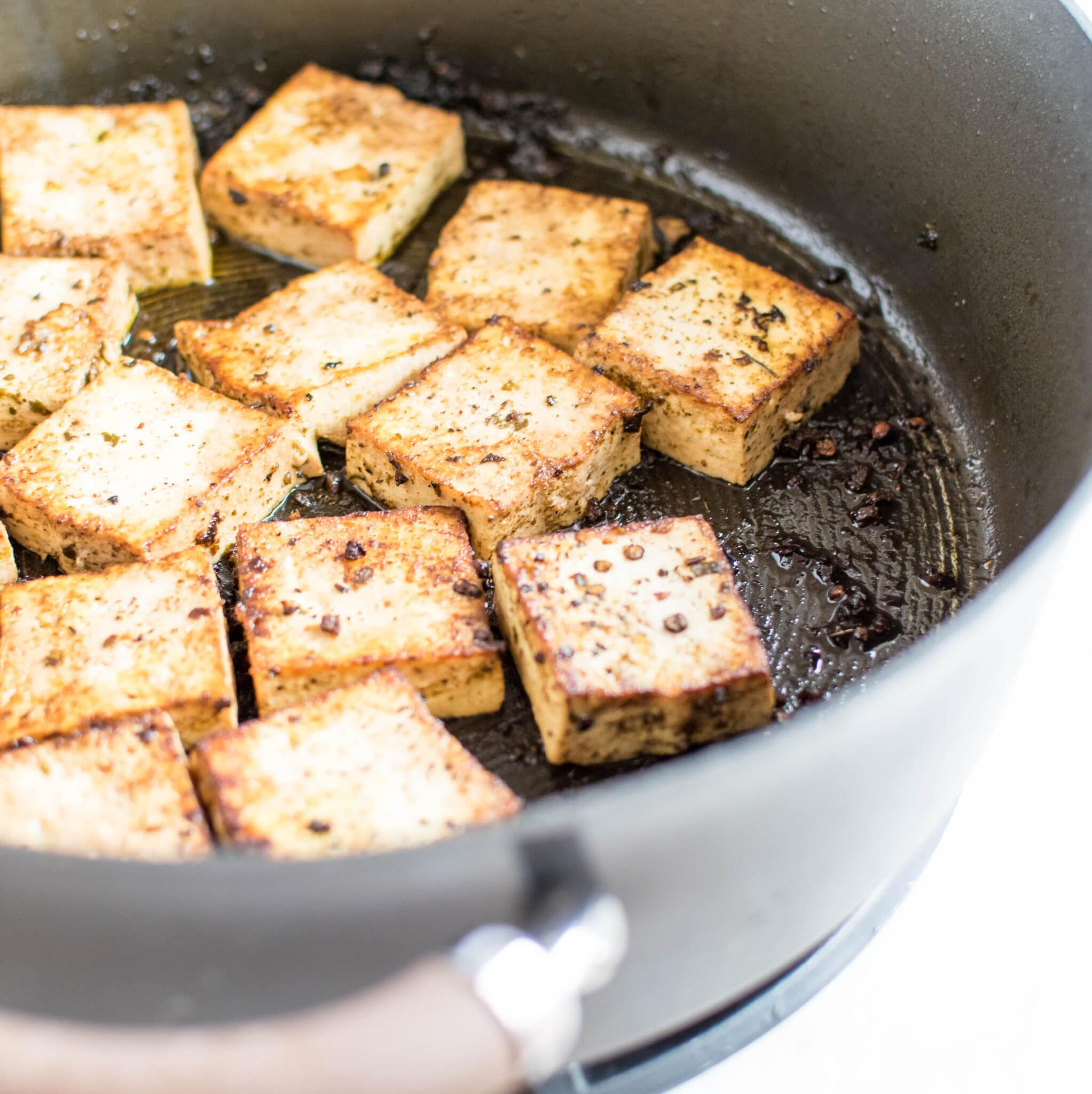 Tofu being cooked in herbs and red wine vinegar is shown in this image   kiipfit.com