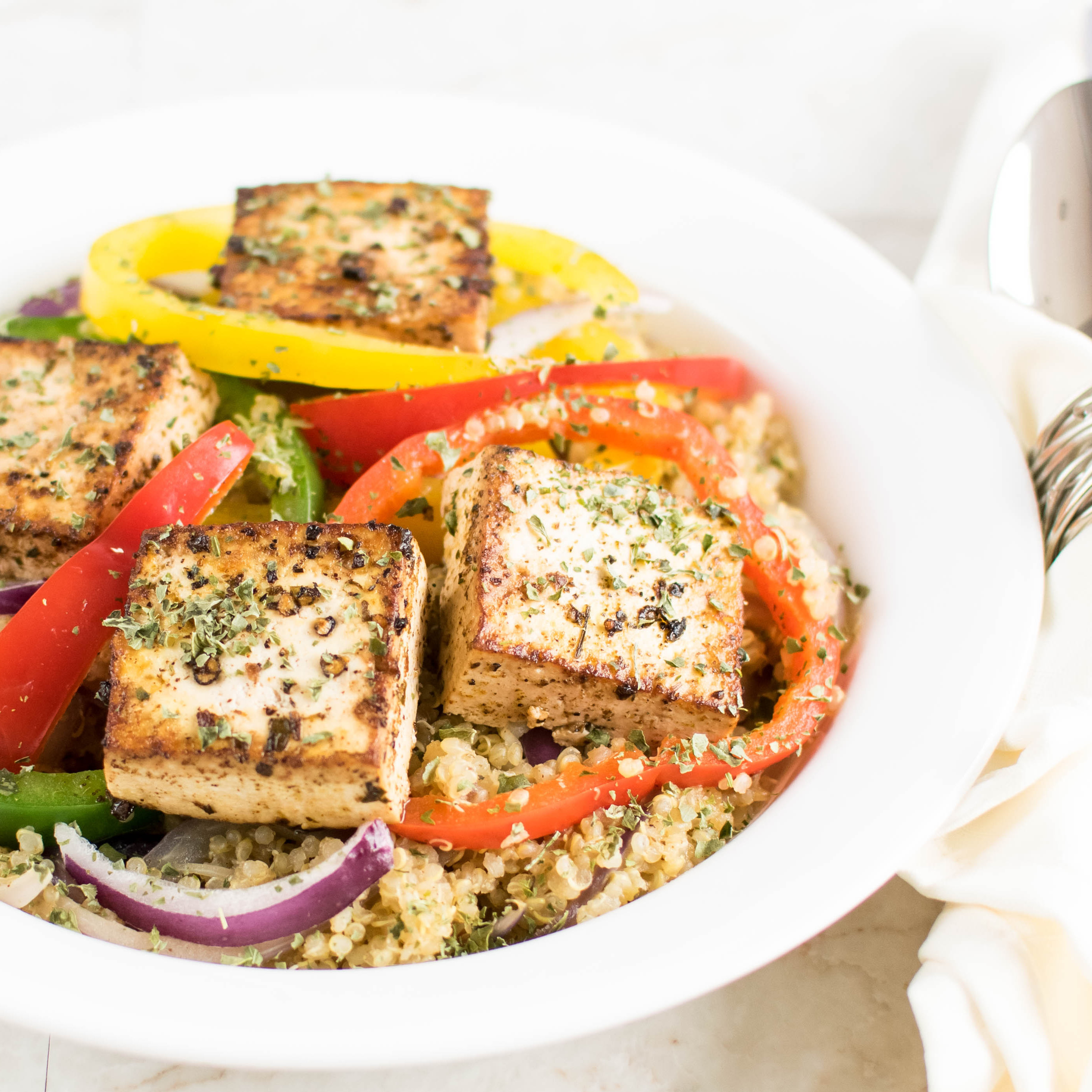 Red Wine Vinegar Tofu with Quinoa is shown plated in this image | kiipfit.com