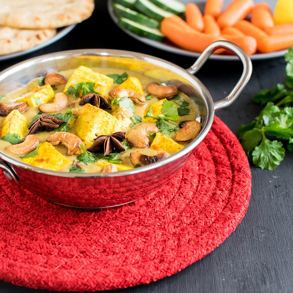 Turmeric Tofu Cashew Curry -I paired this vegan and gluten free entree with whole grain naan and a side onion salad and served it warm. It was a fun dinner evening with my family enjoying my new recipe. This is so easy to cook and gets ready within 30 minutes that you can enjoy it with your family even on a weeknight   kiipfit.com