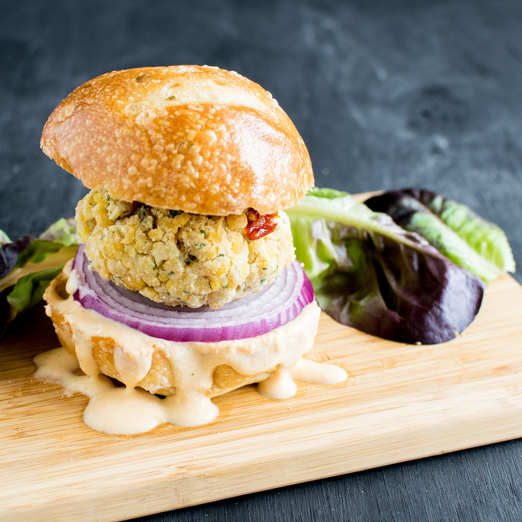 The gorgeous Tempeh Parmesan Burger with Habanero Dip is simply calling out all the burger lovers. Made with simple ingredients, these burgers are bursting with flavors, especially when Habanero dip generously flows out of the burger while digging your teeth in it | vegan and dairy free | kiipfit.com
