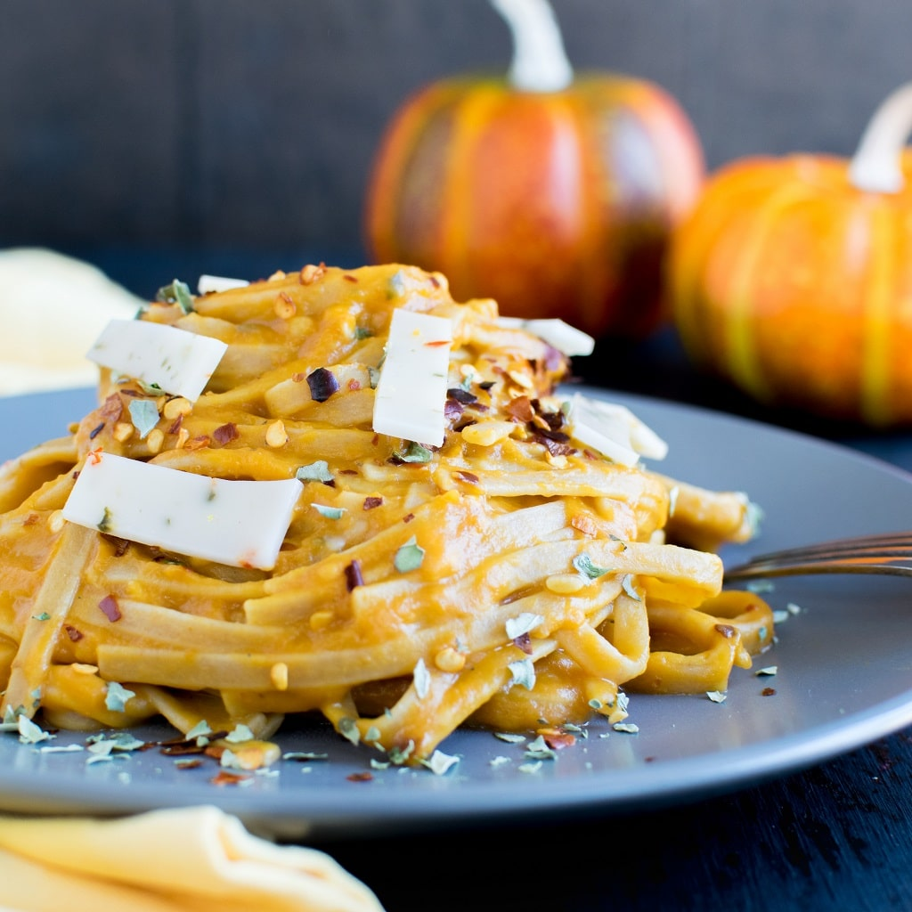 Vegan Pepper Jack Pumpkin Fettuccine is made with the goodness of pumpkin and vegan flavored cheese and folded in with fettuccine pasta. However, gluten free fettuccine goes well in this recipe too [ oil free ] | kiipfit.com