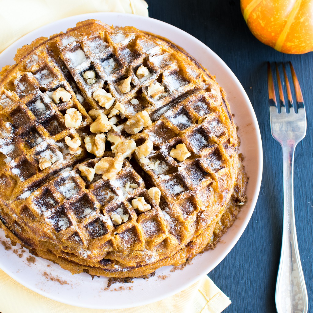 Pumpkin Pie Spice Spelt Waffles from top view with sprinkled sugar and raw walnuts [ vegan ] kiipfit.com