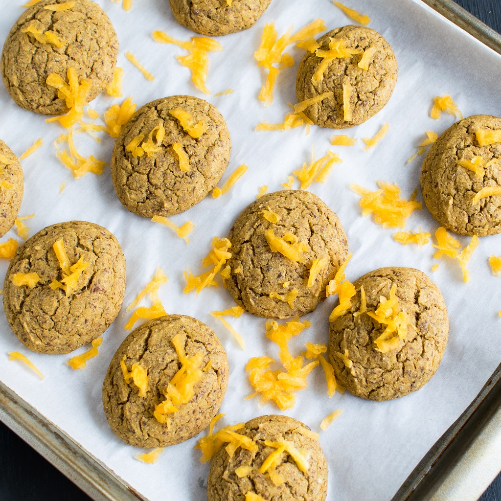 Butternut Squash Barley Vegan Cookies placed at regular intervals on a lined cookie sheet [ oil free + nut free } kiipfit.com