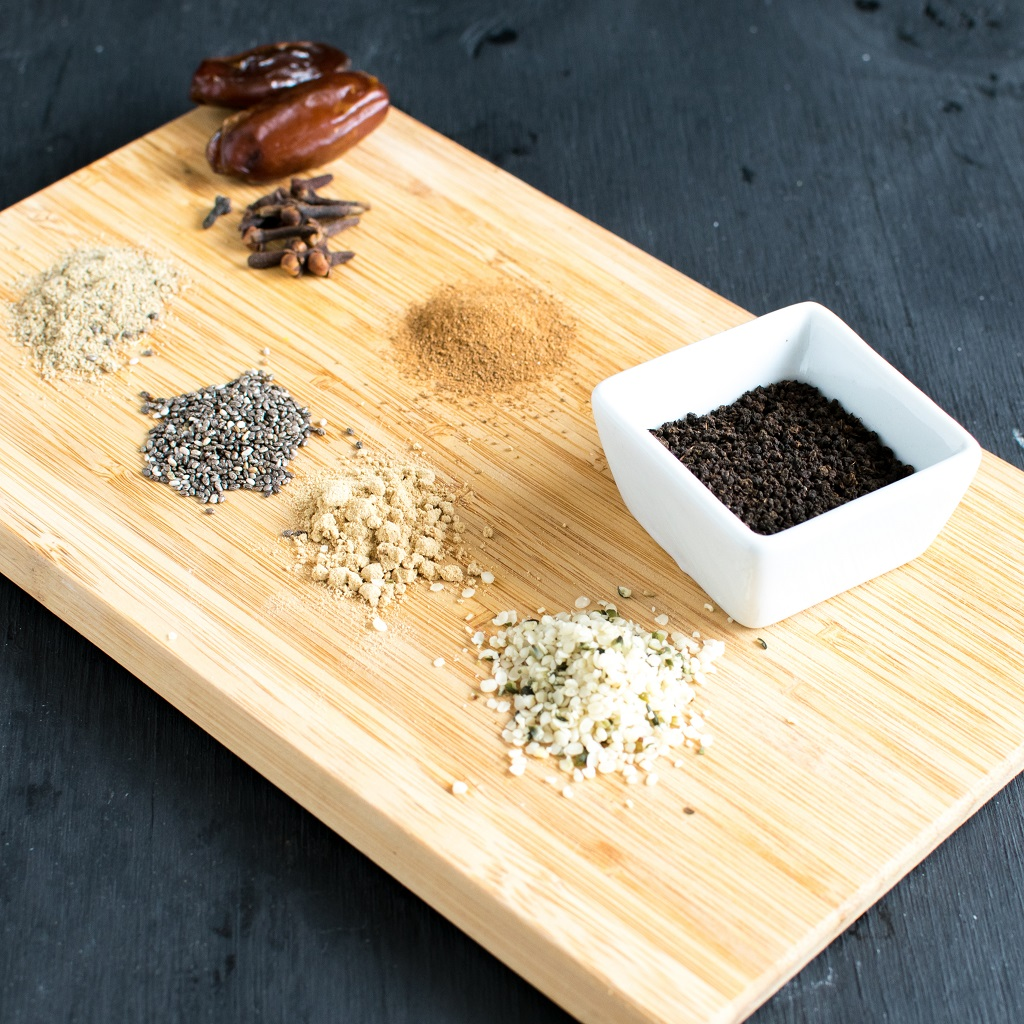 The raw ingredients of Masala Chai Protein Smoothie is displayed on a wooden board | kiipfit.com