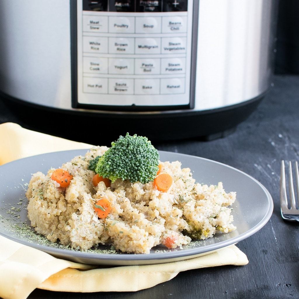Pressure Cooker Vegan Cheese Vegetable Quinoa is a wholesome, cheesy yet nutritious one dish meal that's perfect for lunch or dinner. Also its super easy to cook without much hassle | kiipfit.com