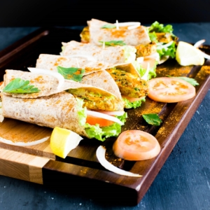 Moroccan Spiced Tempeh Wraps are savory, spicy and easy meal. These vegan wraps are wholesome, hearty and filling with high content of protein + fiber. It's great for lazy weeknight dinners. The leftovers satisfy perfectly for lunch the next day [ Vegan + GF ] kiipfit.com