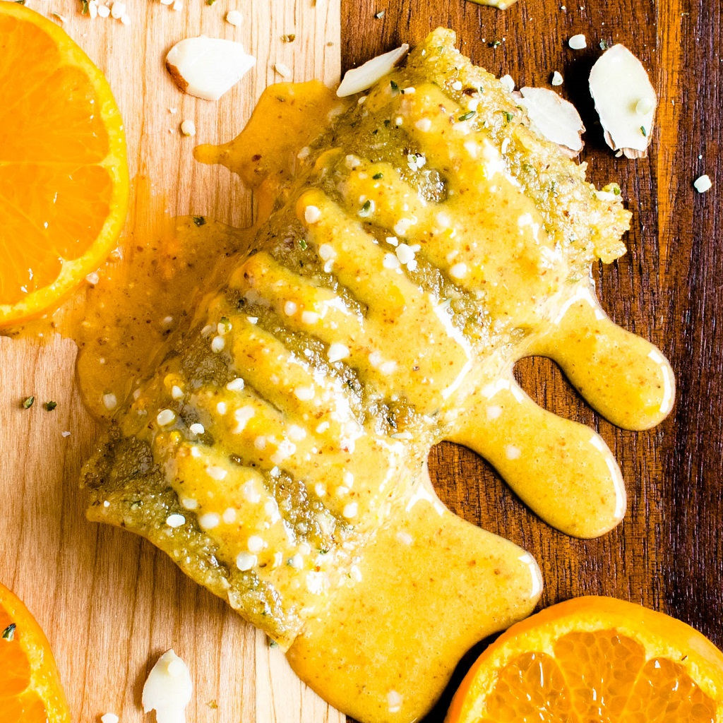 a close up view of No Bake Orange Almond Protein Bars is shown in this image | kiipfit.com