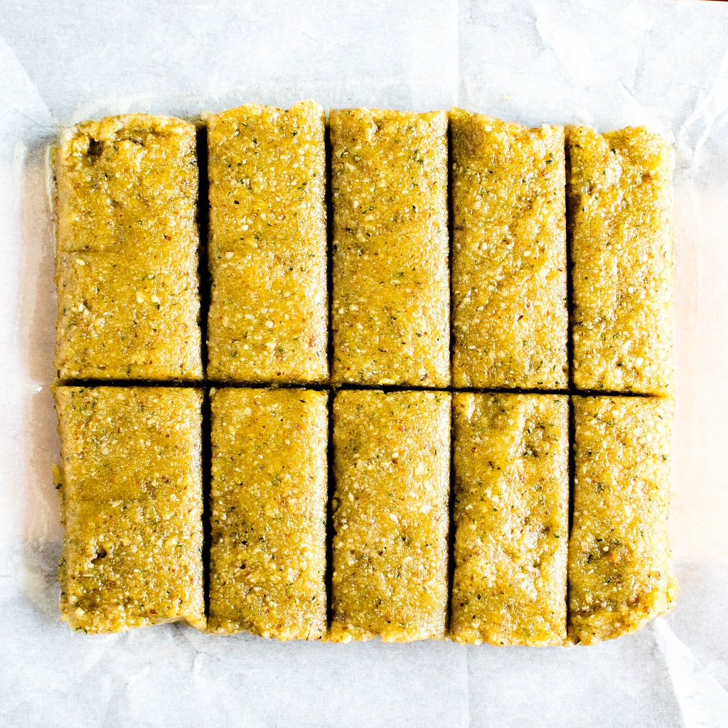 No Bake Orange Almond Protein Bars are shown on a parchment paper without any frosting | kiipfit.com