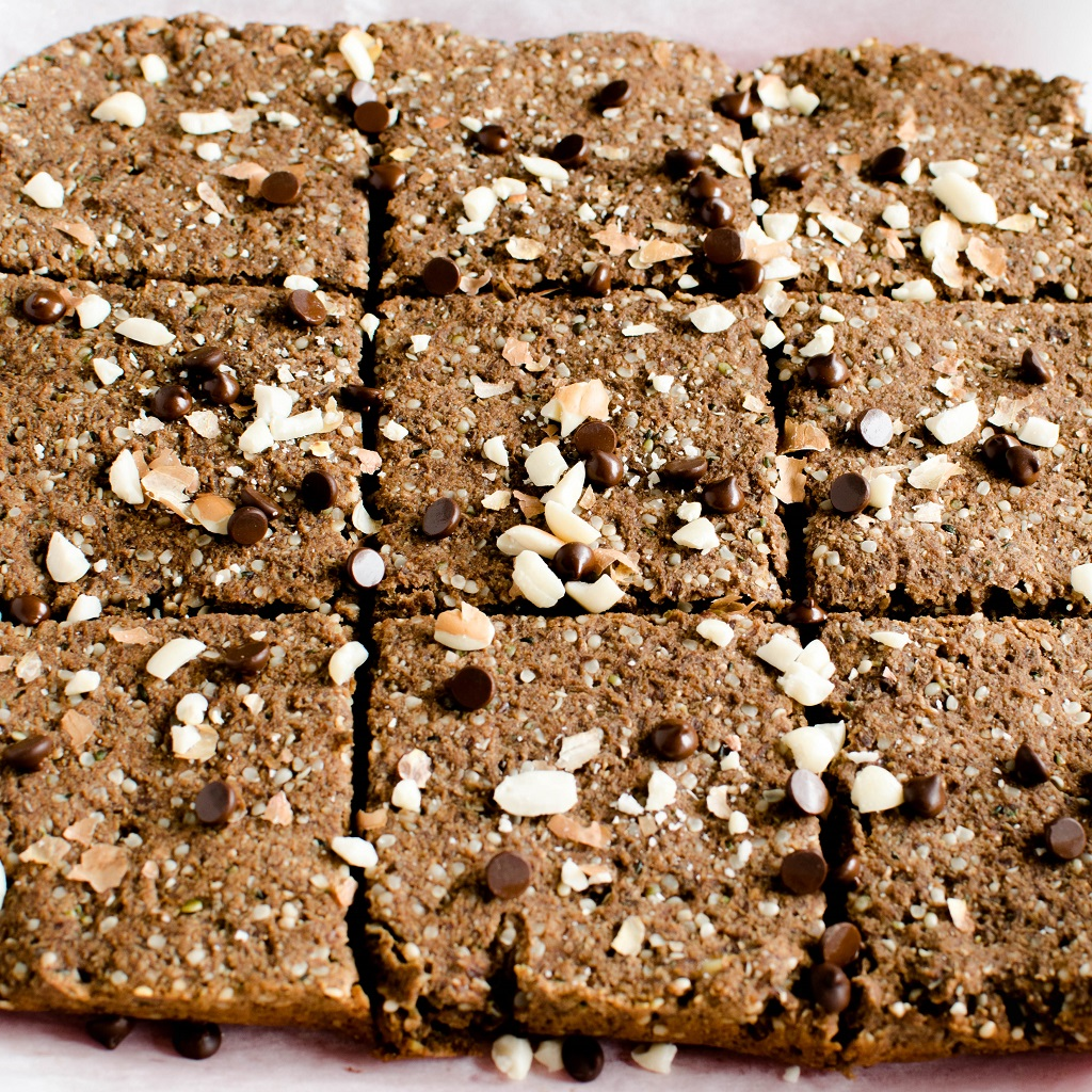 Superfood Peanut Butter Chocolate Brownies are shown on the parchment paper cut into slices and straight out of the oven | kiipfit.com