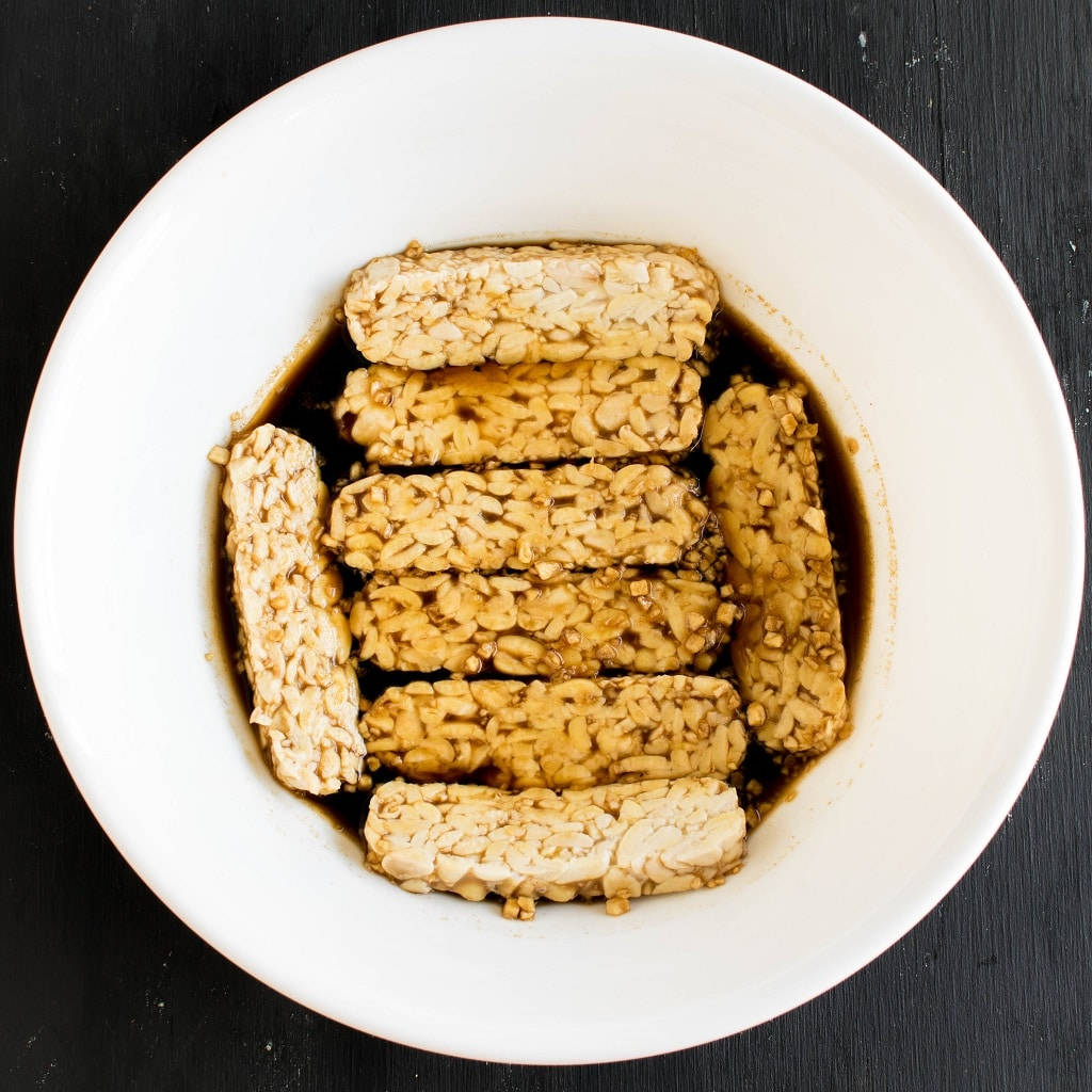 Tempeh is shown in the process of marinating | kiipfit.com