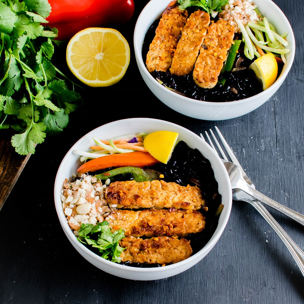 Black Rice Sriracha Tempeh Bowl is a vegan and gluten free meal for any week nights. It's a wholesome delectable meal loaded with antioxidant and protein. It is high in fiber and is a medley of Asian flavors [ Vegan + GF ] kiipfit.com