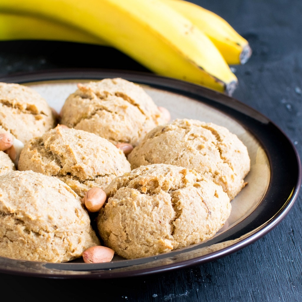 Loads of Peanut Butter Banana Amaranth Cookies are shown in a plate with raw peanuts and banana as the props | kiipfit.com