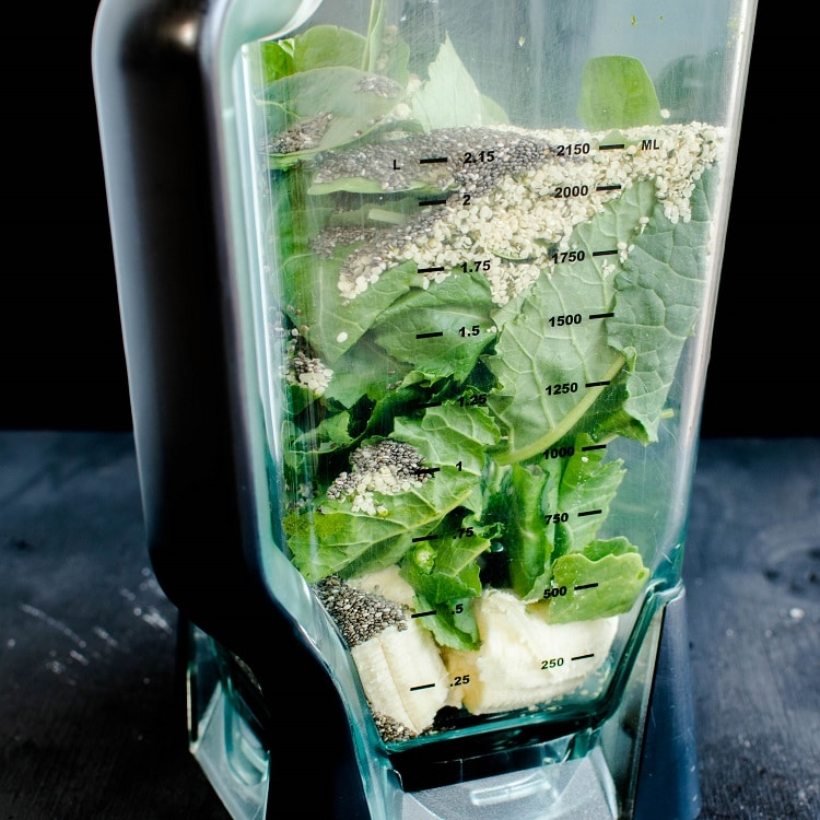 The raw ingredients of Chia Hemp Smoothie in a blender in shown in this image.