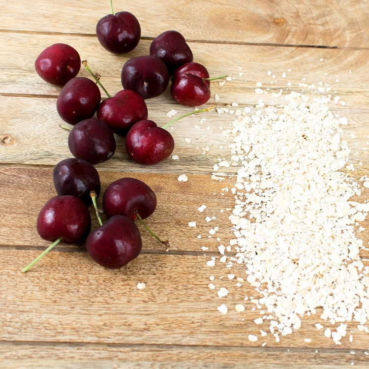 The raw ingredients of cherry oatmeal vegan pancakes are shown in this image
